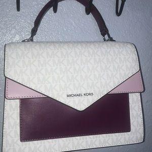 Handbags - Pink Michael Kors purse.